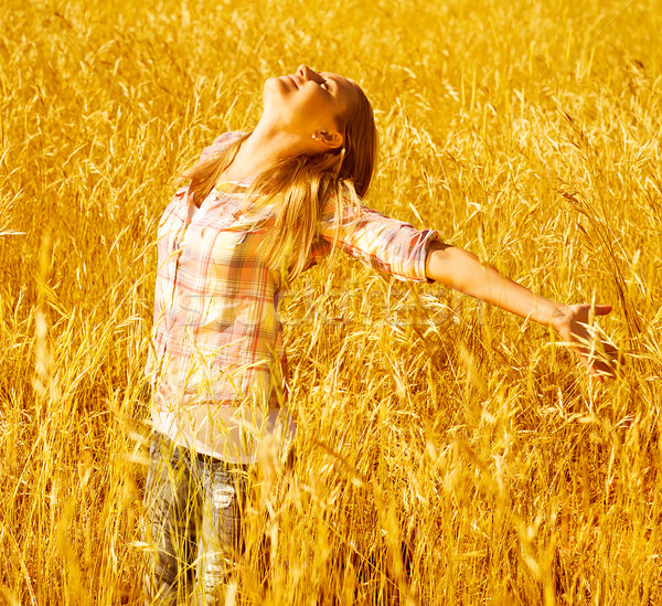 2156242_stock-photo-girl-on-autumn-wheat-field